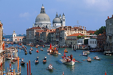 Historical regatta 'Regatta Storica', gondolas on Grand Canal and Church Santa Maria della Salute, Venice, Italy