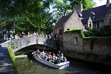 Boat with tourists on canal 'Arendshof', Bruges, West-Flanders, Belgium