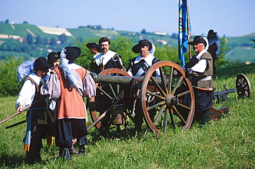 Men playing historical battle, Canelli, Piemont, Italy / canon