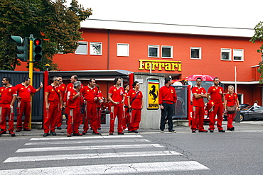 Workers leave Ferrari Factory, with entrance and sign in background, Maranello, Emilia-Romagna, Italy, Europe