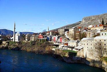 Koski Mehmed Pasa Mosque and coloured buildings from rebuilt Old Bridge, Mostar, Herzegovina, Bosnia And Herzegovina, Europe