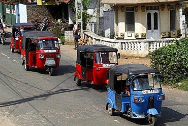 Red and blue tuk-tuks, Matale, Sri Lanka, Asia