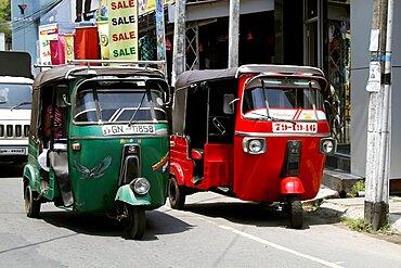 Green and red tuk-tuks, Galle, Sri Lanka, Asia