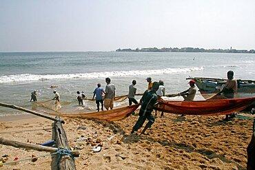 Fishermen pull nets from the Indian Ocean, Galle, Sri Lanka, Asia