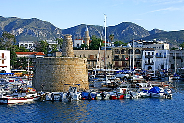Boats in harbour and castle walls, Kyrenia, Northern Cyprus, Mediterranean, Europe