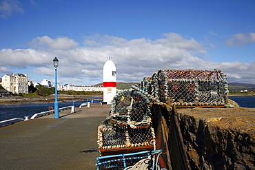 Lobster pots, blue lamppost and Lighthouse, Isle of Man, British Isles, Europe