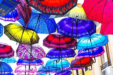 Colorful umbrellas hanging in a street, Skopje, Macedonia, Europe
