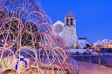 Illuminated modern Christmas tree in front of the Parish Church, Alcochete, Setubal Province, Portugal, Europe