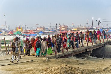 Pilgrims crossing the Ganges river on a temporary pontoon bridge, Allahabad Kumbh Mela, Allahabad, Uttar Pradesh, India, Asia