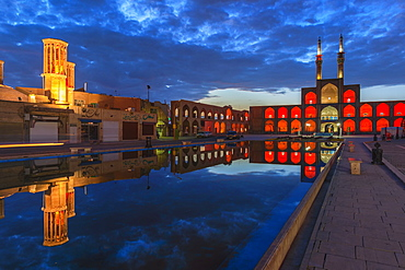 Amir Chaqmaq complex facade illuminated at sunrise and reflecting in a pond, Yazd, Yazd province, Iran, Middle East