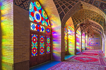 Nasir-ol-Molk Mosque (Pink Mosque), light patterns from colored stained glass illuminating the iwan, Shiraz, Fars Province, Iran, Middle East