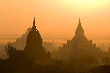 Temples and pagodas at sunrise, Bagan (Pagan), Myanmar (Burma), Asia