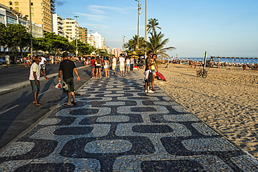 People walking along the sidewalk at Ipanema Beach, Rio de Janeiro, Brazil, South America