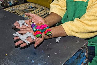 Woman presenting figurines made of masapan (bread dough), Calderon, Pichincha Province, Ecuador, South America