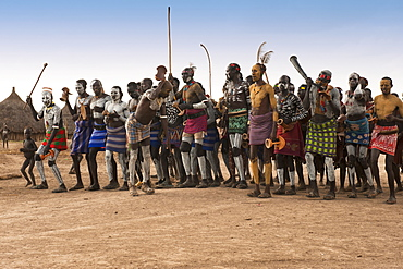 Karo people with body paintings participating in a tribal dance ceremony, Omo River Valley, Southern Ethiopia, Africa