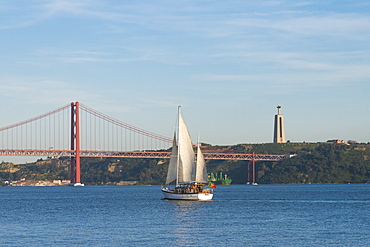 Sailboat navigating on the Tagus River near the Ponte 25 de Abril, Belem, Lisbon, Portugal, Europe