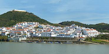 Sanlucar de Guadiana village seen from the Portuguese city Alcoutim, Spain, Europe