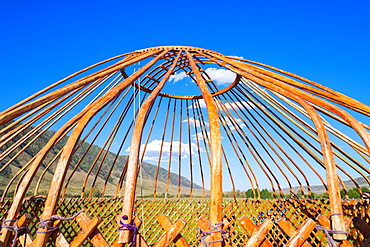 Kazakh men putting up a yurt, Sati village, Tien Shan Mountains, Kazakhstan, Central Asia, Asia
