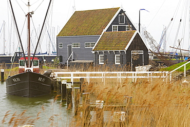 Boats and building in the Zuidersee Open-Air Museum, Enkhuizen, North Holland, Netherlands, Europe