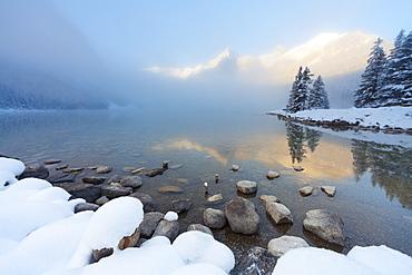Foggy sunrise at Lake Louise, Banff National Park, UNESCO World Heritage Site, Rocky Mountains, Alberta, Canada, North America