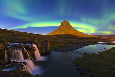 Aurora (Northern Lights) over a moonlit Kirkjufell Mountain, Snaefellsnes Peninsula, Iceland, Polar Regions