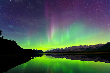 Aurora (Northern Lights) reflected in Lower Kananaskis Lake, Peter Laugheed Provincial Park, Alberta, Canada, North America