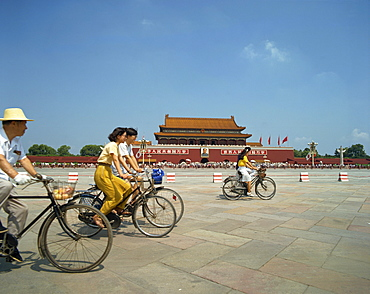 People cycling through Tiananmen Square outside the Forbidden City, Beijing, China, Asia