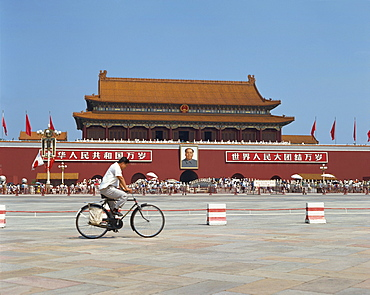 Man cycling through Tiananmen Square with portrait of Mao Tse Tung behind, Forbidden City, Beijing, China, Asia