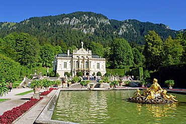 Gilded statues and pool in the gardens in front of Linderhof Castle, Bavaria, Germany, Europe