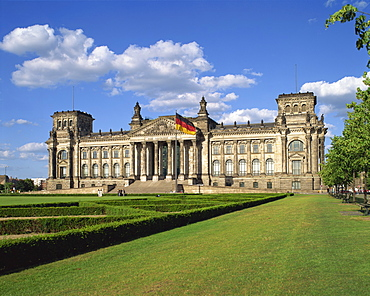 The German flag flies in front of the Reichstag in Berlin, Germany, Europe