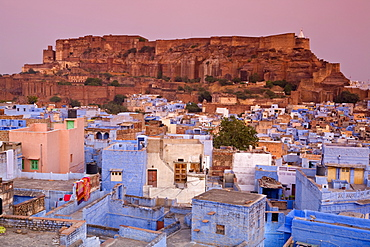 Elevated view over colorful houses of the Blue City towards Meherangarh Fort, Jodhpur, Western Rajasthan, India, Asia