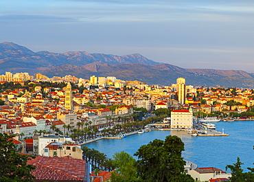 Elevated view over Split's picturesque Stari Grad and harbour illuminated at sunset, Split, Dalmatia, Croatia, Europe - 1158-478