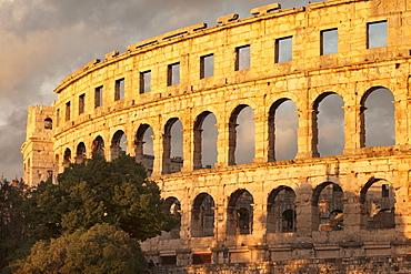 Roman amphitheatre at sunset, Pula, Istria, Croatia, Europe