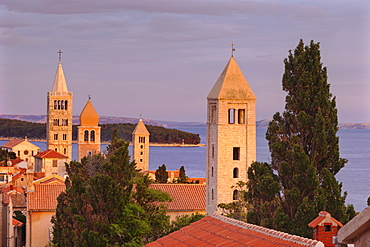 Old town of Rab town with Belfry of St Justine's church, great bell tower of St. Mary's church, campanile of church of St. John and campanile of monastery of St. Andrew at sunset, Rab town, Rab Island, Kvarner region, Dalmatia, Adriatic Sea, Croatia, Europe