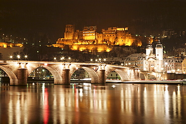 View over the Neckar River to Karl Theodor Bridge, Stadttor gate and castle in winter, Heidelberg, Baden Wurttemberg, Germany, Europe