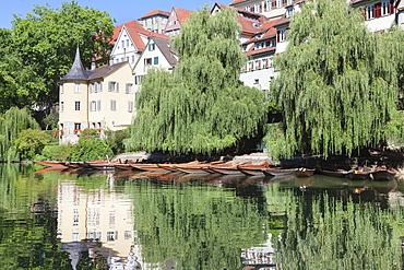 Holderlinturm tower and Stocherkahn (punt) reflecting in Neckar River, Tubingen, Baden Wurttemberg, Germany