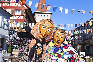 Couple in traditional costumes of Witch and Spattlehansel, Swabian Alemannic carnival, Gengenbach, Black Forest, Baden Wurttemberg, Germany, Europe