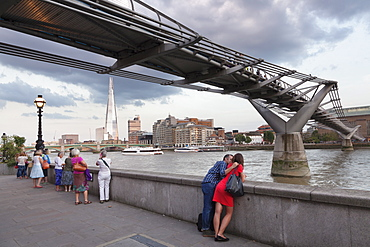 View of Millennium Bridge over River Thames at Southwark with The Shard skyscraper, architect Renzo Piano, in distance, London, England, United Kingdom, Europe