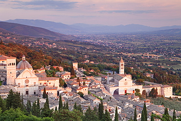 View over Assisi to Santa Chiara Basilica and San Rufino Cathedral at sunset, Assisi, Perugia District, Umbria, Italy, Europe