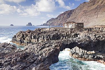 Rock arch and Hotel Punta Grande, Las Puntas, El Golfo, lava coast, UNESCO biosphere reserve, El Hierro, Canary Islands, Spain, Atlantic, Europe