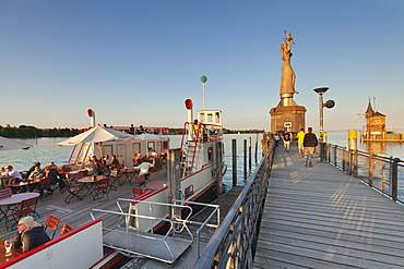 Statue of Imperia by Peter Lenk at the seaport, restaurant on a ship, Konstanz, Lake Constance, Baden-Wurttemberg, Germany, Europe