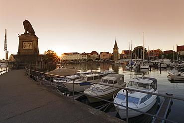 Bavarian Lion and Mangturm at the port at sunset, Lindau, Lake Constance, Bavaria, Germany, Europe