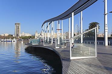 Rambla del Mar at Port Vell, Edificio Colon Tower and Columbus Monument (Monument a Colom), Barcelona, Catalonia, Spain, Europe