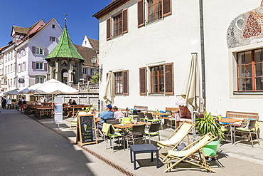 Street cafe on pedestrian area Munsterstrasse, Oelbergkapelle Chapel in the back, Uberlingen, Lake Constance, Baden-Wurttemberg, Germany, Europe
