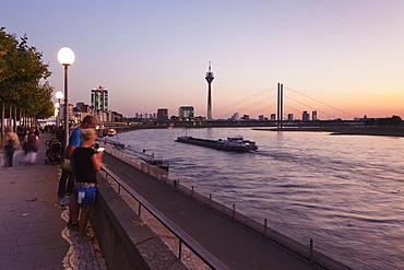 Rhein promenade with Rheinturm tower and Rheinkniebrucke bridge, Dusseldorf, North Rhine Westphalia, Germany, Europe