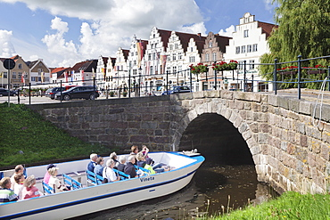 Excursion boat on a canal, Friedrichstadt, Schleswig Holstein, Germany, Europe
