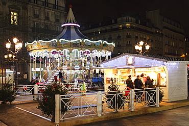 Carousel at Place de l' Hotel de Ville at Christmas season, Paris, Ile de France, France, Europe