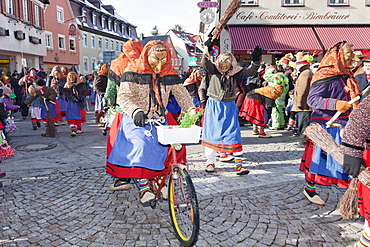 Two witches on a bike, Swabian Alemannic Carnival, Gengenbach, Black Forest, Baden Wurttemberg, Germany, Europe