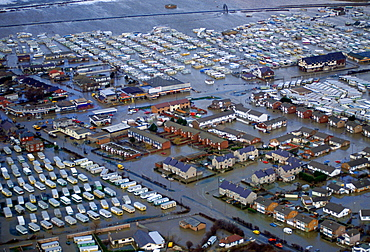 The flooded town of Towyn in North Wales. Caravans in a mobile home park and caught up in the disaster.  Streets of houses are surrounded by the flood waters.