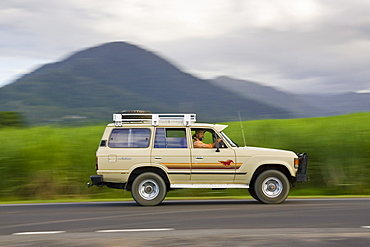 Four-wheel-drive vehicle on roadway near Cairns, Queensland, Australia
